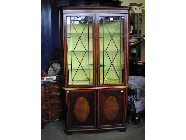 A 19th century and later mahogany glazed corner cabinet with cupboard under, 104 cm wide.