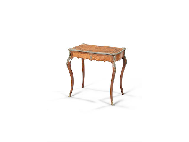 An early 20th Century Louis XV style kingwood, rosewood and marquetry writing table,