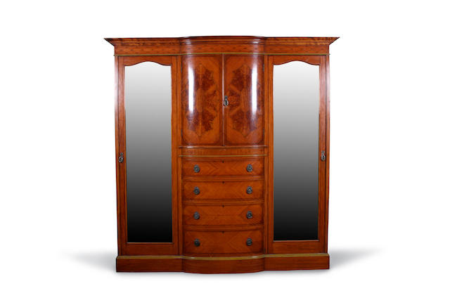 An Edwardian satinwood wardrobe and inlaid bow breakfront triple wardrobe