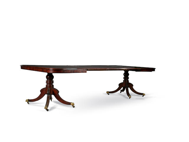 A George III and later  mahogany twin pedestal dining table