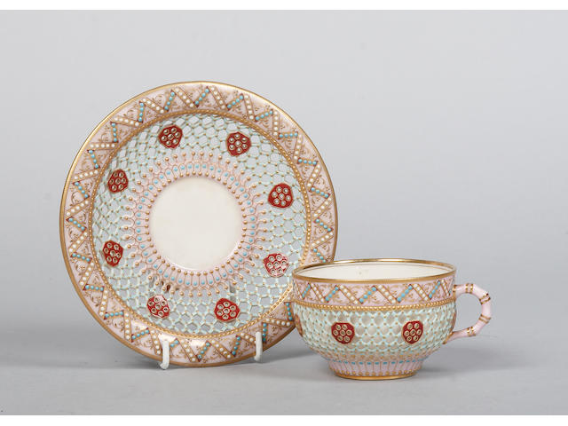 A reticulated and jewelled Worcester cabinet cup and saucer circa 1880