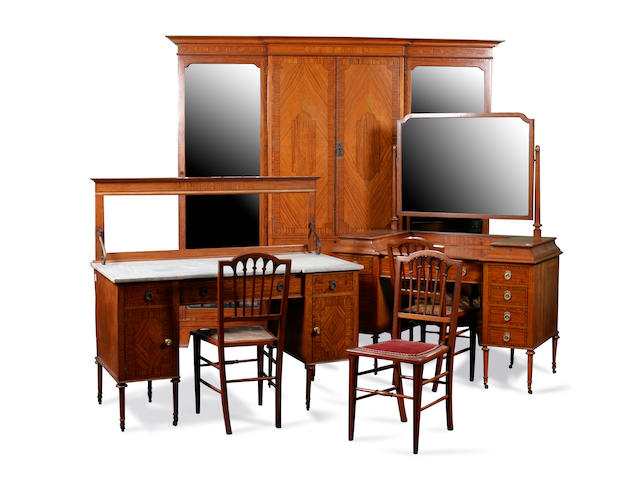 An Edwardian satinwood and inlaid six-piece bedroom suite