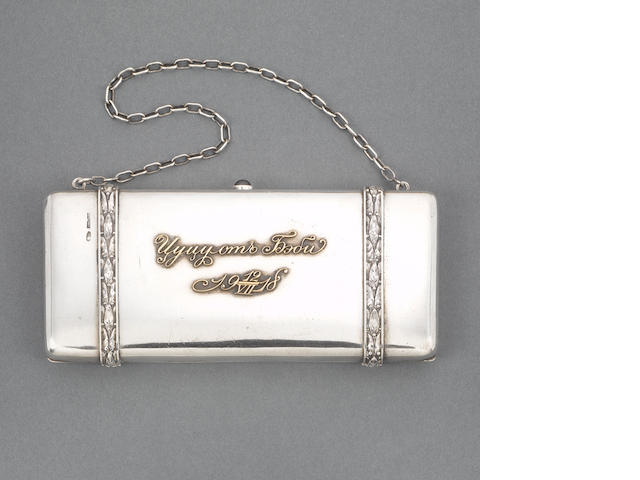 An early 20th century Russian silver and gold applied purse with chain handle, 1908 - 1917, together