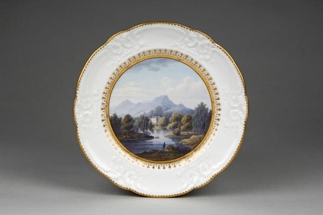 A important Nantgarw plate, painted with a landscape circa 1818-20