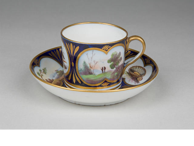 An important Coalport coffee can and saucer circa 1812