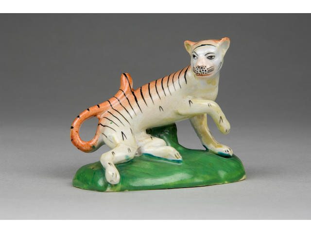 An important unrecorded Cambrian pottery model of a tiger circa 1820