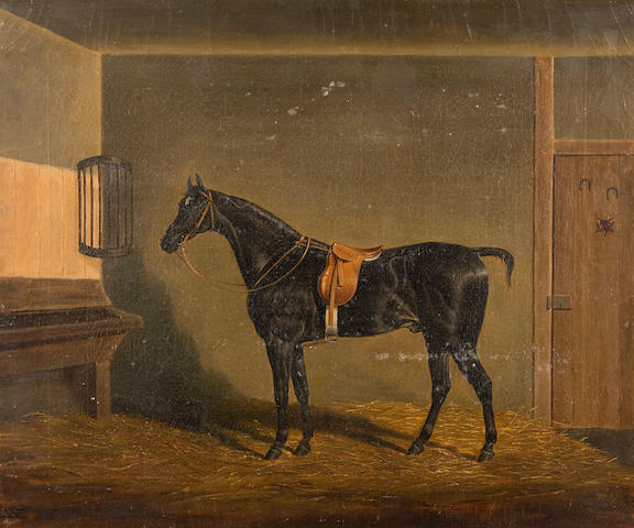 James Loder of Bath (British, 1784-1860) A saddled black hunter in a stable