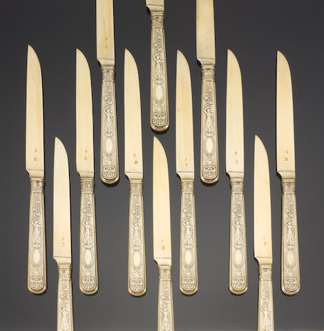 A set of twelve 19th century French silver-gilt dessert knives, by Pierre Queille, Paris circa 1840,