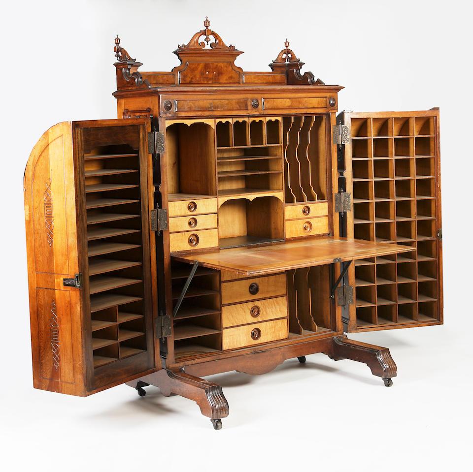An American late 19th century mahogany and walnut 'Standard Grade' Wooton Patent Desk