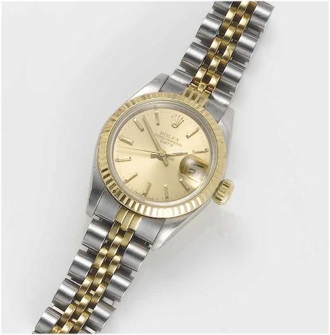 Rolex. A lady's stainless steel and gold centre seconds calendar bracelet watch Date, 1984