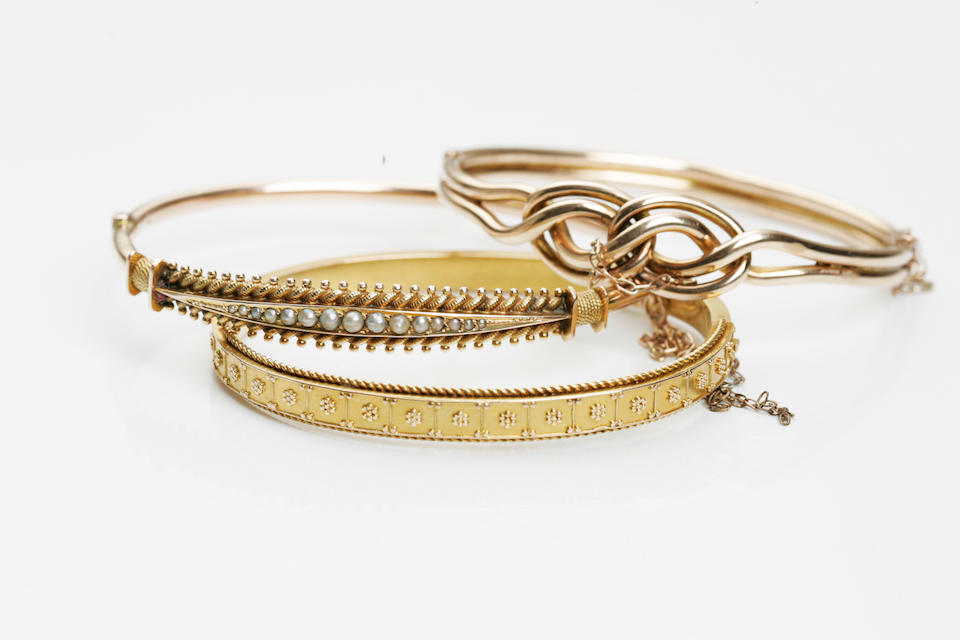 A collection of three Victorian gold bangles