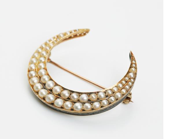 A Victorian pearl crescent brooch