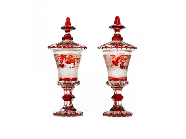 A pair of late 19th century Bohemian etched glass vases and covers