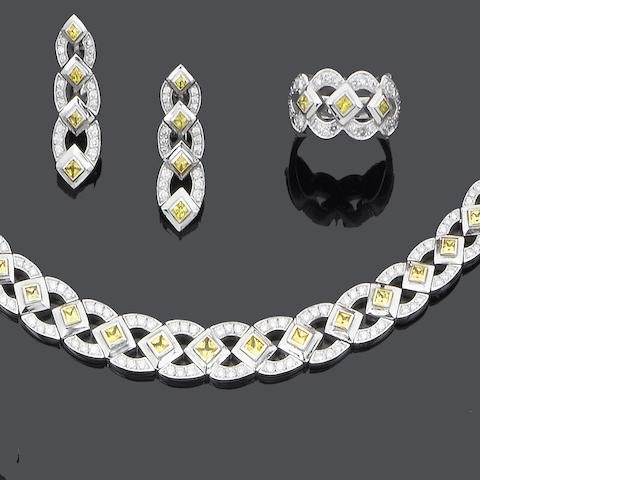 A diamond and yellow sapphire collar necklace, bracelet, ring and earring suite
