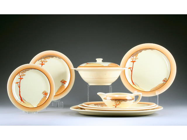 A Clarice Cliff 'Coral Firs' dinner service