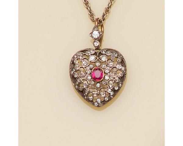 A Victorian ruby and diamond heart-shaped locket pendant