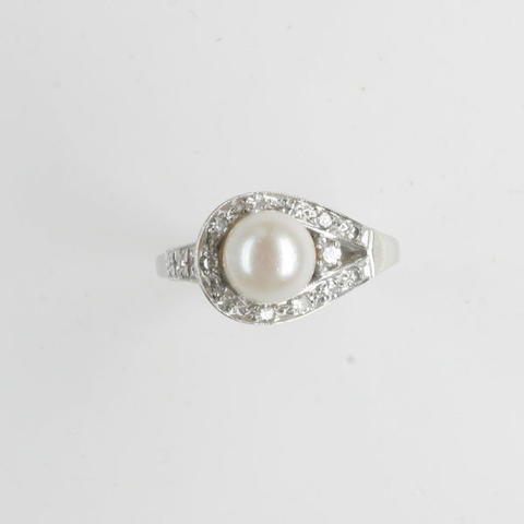 A diamond and cultured pearl dress ring