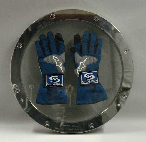 A pair of racing gloves worn by Fernando Alonso,