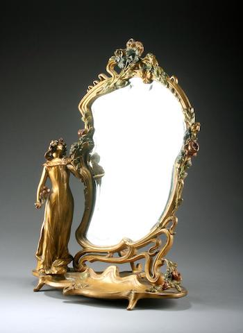 An Art Nouveau gilt metal dressing table mirror, circa 1900,