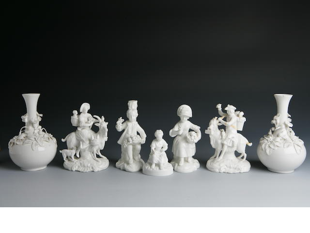 A pair of blanc de chine Derby figure groups marked for 1861-1935
