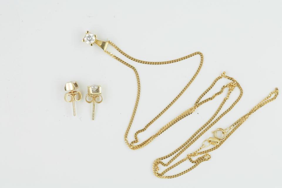 A diamond pendant and earrings