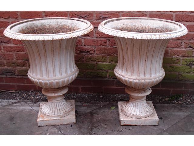 A good pair of Victorian cast iron campana garden urns