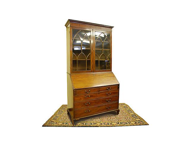 A large George III mahogany bureau with associated bookcase