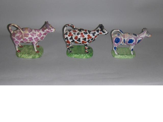 Three Swansea cow creamers and covers