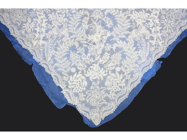 A triangular raised Honiton lace shawl