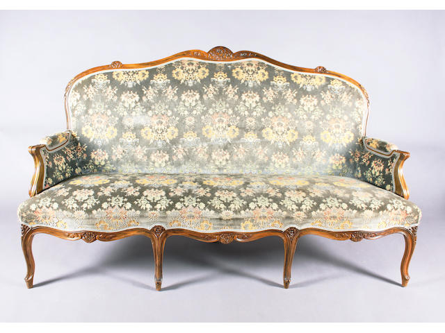 A late 19th Century, Louis XV style, floral carved and moulded walnut frame upholstered salon type suite