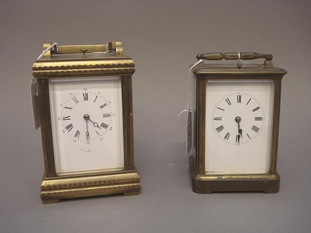 A brass cornice cased carriage clock