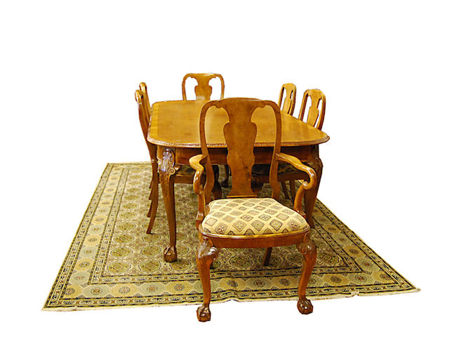 A reproduction walnut dining suite, in early 18th Century style
