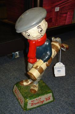 A very rare Dunlop 65 Caddie point of sale figurine