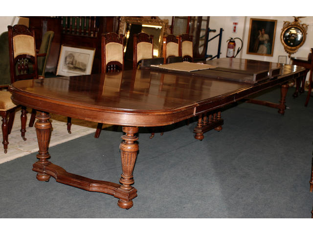 An early 20th century French walnut extending dining table