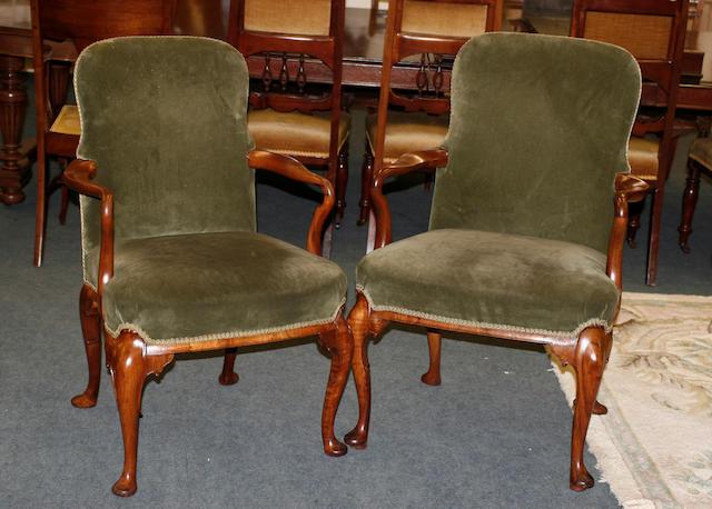 A set of nine George II style walnut armchairs