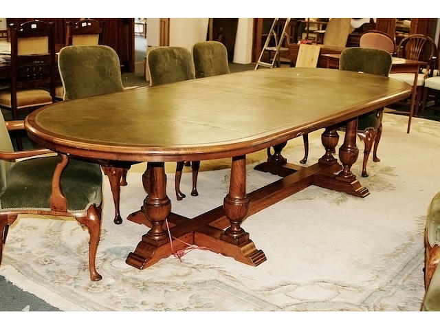 A mid 20th century walnut board room table