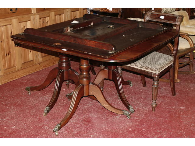 A mahogany triple pillar dining table 19th century and later,