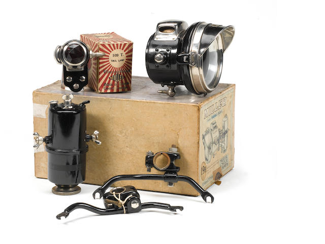 A boxed Miller acetylene motorcycle lighting set comprising remote generator;