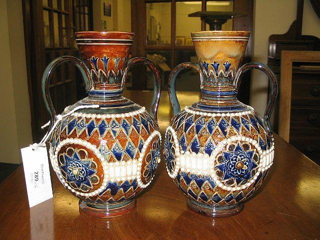 A pair of Doulton Lambeth stoneware vases
