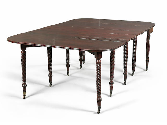 A George IV mahogany concertina action dining table circa 1825,