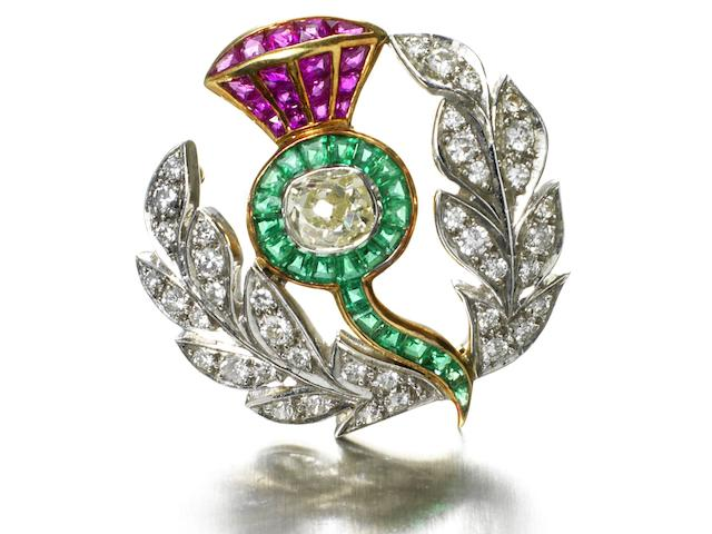 A fine early 20th Century ruby, emerald and diamond thistle brooch