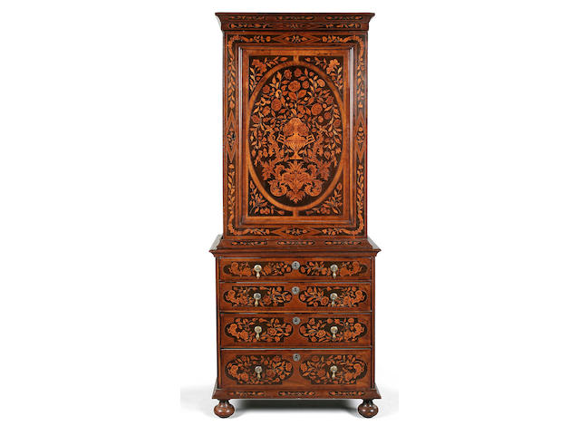 A 19th century Dutch walnut, ebony and floral marquetry cabinet