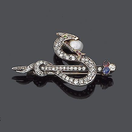 A mid 19th century diamond and gem-set serpent brooch,
