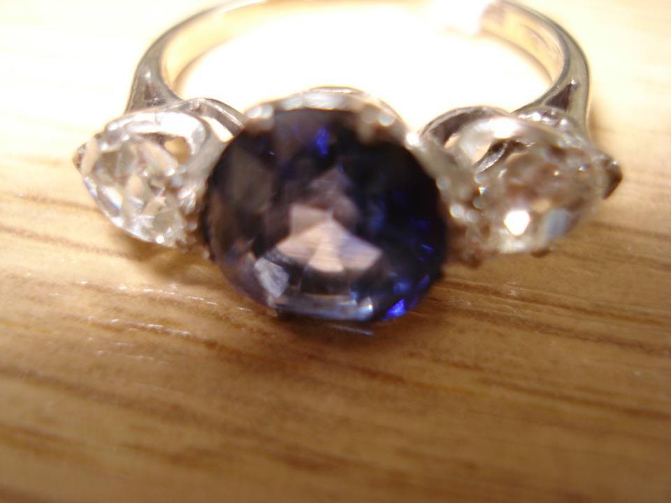A sapphire and diamond three stone ring