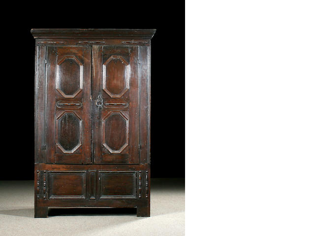 A late 17th Century and later oak livery cupboard