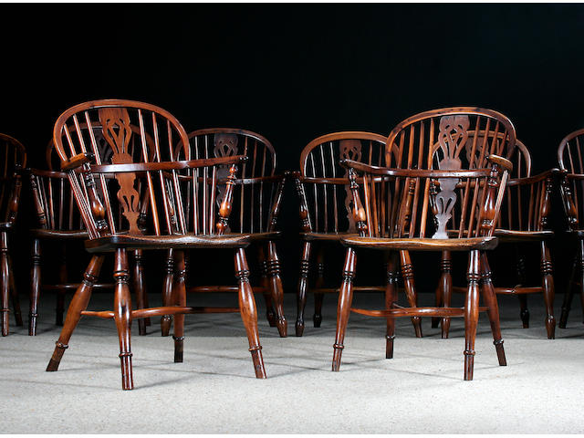 A harlequin set of eight 19th Century yew and elm Windsor elbow chairs