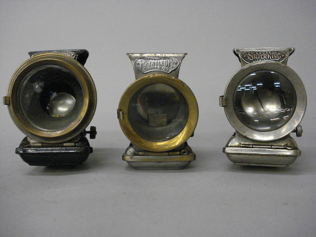 Three Lucas oil illuminated cycle lamps comprising Silver King,