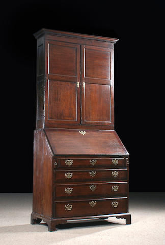 An early 19th Century oak bureau cabinet