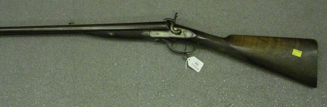 A Double Barrelled Pinfire Shotgun