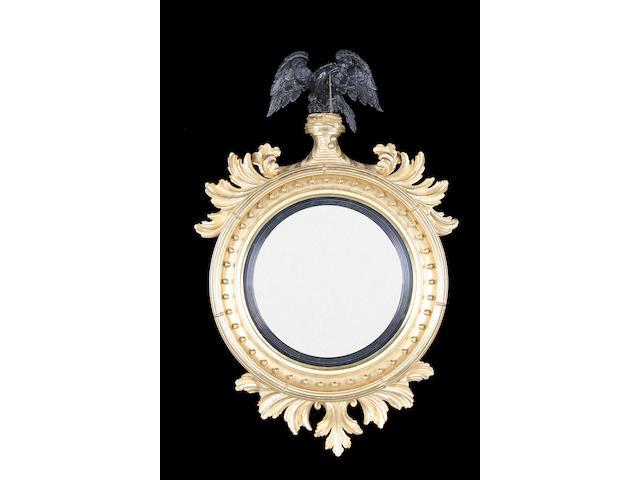 A large Regency giltwood convex mirror circa 1810